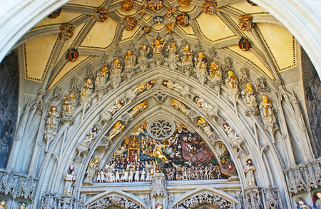 munster: The central portal of the Munster Cathedral of Berne is decorated with the Last Judgement sculptural composition, Switzerland. Stock Photo