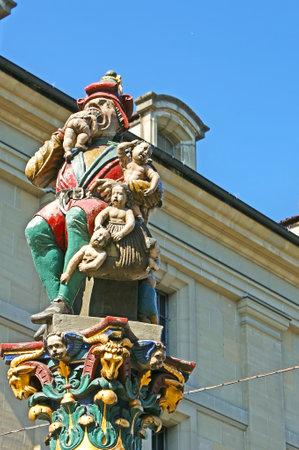 The medieval Child Eater Fountain, named Kindlifresserbrunnen or Platzbrunnen, depicting the ogre, that eats misbehaving children, Kornhausplatz square, Bern, Switzerland.