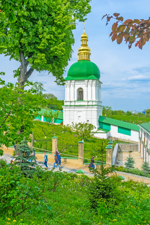 KIEV, UKRAINE - MAY 2, 2016: The view on Belfry in the Middle Caves through the monastery garden, on May 2, in Kiev Editorial