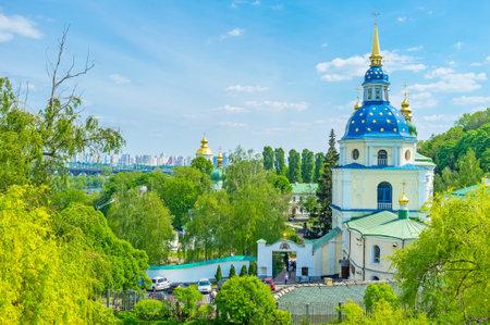 KIEV, UKRAINE - MAY 2, 2016: The view on Vydubychi Monastery from Botanical Garden in Kiev, on May 2, in Kiev