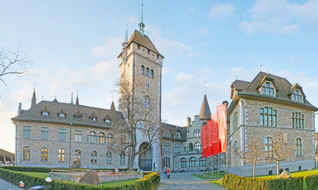 ZURICH, SWITZERLAND - MARCH 20, 2011: Panorama of Swiss National Museum built in form of French Chateau and surrounded by ornamental garden, on March 20 in Zurich.