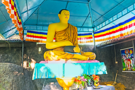 vihara: UNAWATUNA, SRI LANKA, DECEMBER 4, 2016: The statue of Sitting Lord Buddha in Sri Viwekaramaya Temple, on December 4 in Unawatuna. Editorial