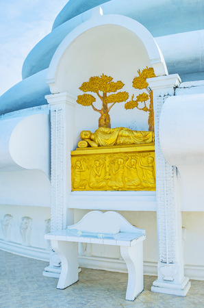 vihara: The golden statue of Lord Buddha in Parinirvana, Japanese Peace Pagoda, Rumassala Mount, Unawatuna, Sri Lanka.