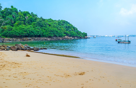 The cozy sand Jungle Beach is the nice place to relax after visiting of Temples on Rumassala Mount, Unawatuna, Sri Lanka.