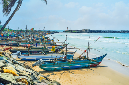 HIKKADUWA, SRI LANKA - DECEMBER 4, 2016: The Kumarakanda harbor, full of fishing canoes, going to the sea many times a day, on December 4 in Hikkaduwa. Editorial