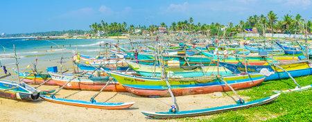 HIKKADUWA, SRI LANKA - DECEMBER 4, 2016: The numerous oruwa boats wait in Kumarakanda harbor to go to the ocean for fresh fish, on December 4 in Hikkaduwa. Editorial