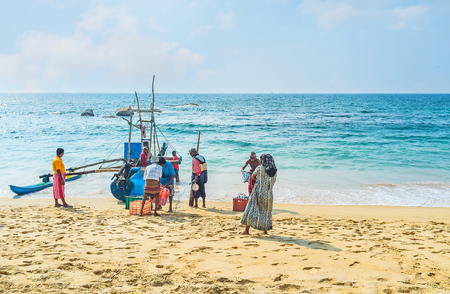 HIKKADUWA, SRI LANKA - DECEMBER 4, 2016: The work of fishing crew after their back from the ocean, on December 4 in Hikkaduwa.