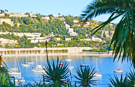 Vacation in lovely resort of French Riviera - Villefranche-sur-Mer, famous for the deepest natural Darse harbor, surrounded by Alps slopes with villas and lush gardens, France.