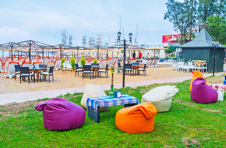 sunshade: The lounge cafes of Kemer offers fresh beverages, tasty local dishes and traditional shisha, Turkey.