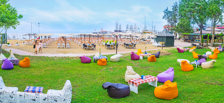 KEMER, TURKEY - MAY 5, 2017: Panorama of the lounge zone at the Moonlight beach with comfortable sun beds on the sand or bean bag chairs on the lawn, on May 5 in Kemer.