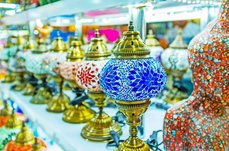 chandelier: KEMER, TURKEY - MAY 5, 2017: The row of handmade table arabian lamps with plafonds of stained glass, covered with interesting patterns, on May 5 in Kemer.