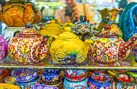 KEMER, TURKEY - MAY 5, 2017: The porcelain teapots decorated with handmade relief Turkish tulips and other floral patterns in the dishes shop of resort, on May 5 in Kemer.