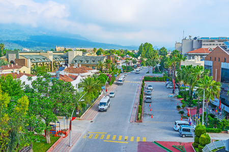 KEMER, TURKEY - MAY 6, 2017: Deniz street is one of the central city roads with numerous hotels, cafes and stores, also there are a lot of greenery here, on May 6 in Kemer. Editorial