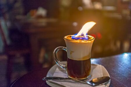 A cup of burning coffee in old bar of Lvov, Ukraine.