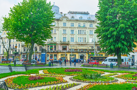 LVOV, UKRAINE - MAY 16, 2017: The park at Svobody avenue decorated with scenic flower beds, on May 16 in Lvov.