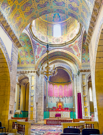 LVOV, UKRAINE - MAY 16, 2017: Interior of Armenian Cathedral of Assumption of Mary with colorful painted patterns on ceiling and walls, on May 16 in Lvov.