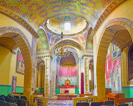 LVOV, UKRAINE - MAY 16, 2017: Panorama of Armenian Cathedral of Assumption of Mary with colorful walls and ceiling, arches and icons, on May 16 in Lvov.
