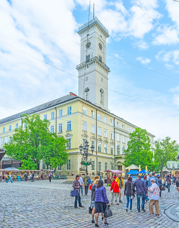 LVOV, UKRAINE - MAY 16, 2017: The clock tower of City Hall is one of the symbols of Old Town, on May 16 in Lvov.