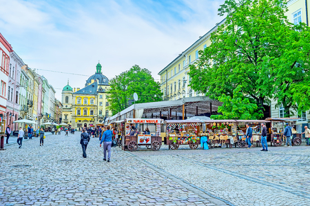 LVOV, UKRAINE - MAY 16, 2017: The tourist market in the Market Square is the best place to choose some souvenirs and taste local snacks, on May 16 in Lvov. Editorial