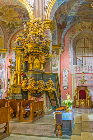 LVOV, UKRAINE - MAY 16, 2017: The amvon of St Andrew the First Called church decorated with sculptures of the Saints and surrounded by frescoes and golden patterns, on May 16 in Lvov.