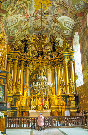 LVOV, UKRAINE - MAY 16, 2017: The altar of St Andrew the First Called church with golden sculptures, tall columns, fine patterns and colorful frescoes around it, on May 16 in Lvov.