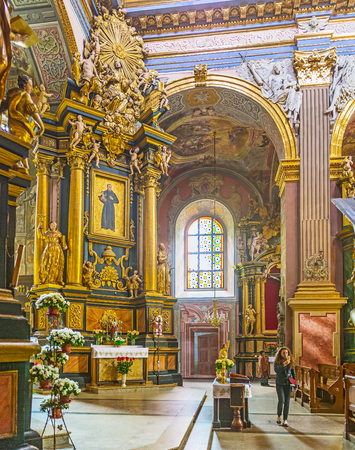 LVOV, UKRAINE - MAY 16, 2017: The St Andrew the First Called church boasts the splendid interior with frescoes, sculptures, reliefs and patterns, on May 16 in Lvov.