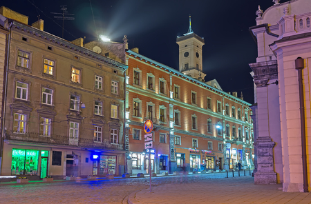 LVOV, UKRAINE - MAY 16, 2017: The evening Old Town is the best place for romantic walks, enjoying bright city lights and medieval architecture, on May 16 in Lvov.