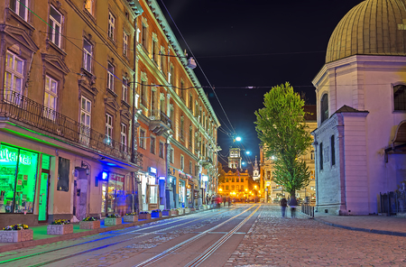 LVOV, UKRAINE - MAY 16, 2017: The bright night streets of Old Town boast the unique atmosphere, on May 16 in Lvov.
