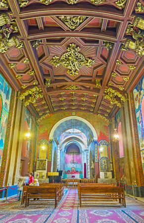 LVOV, UKRAINE - MAY 16, 2017: The prayer hall of Armenian Cathedral with carved wooden ceiling and walls, covered with frescoes, on May 16 in Lvov. Editorial