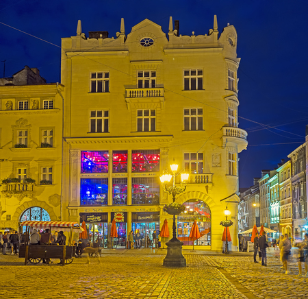 LVOV, UKRAINE - MAY 16, 2017: The Old Town is the best place for the evening walks, Market Square (Ploshcha Rynok) changes its look in bright illumination, on May 16 in Lvov. Editorial