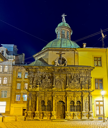 The evening view of the Boim Chapel, one of the main landmarks of Cathedral square with large amount of carved decors on its sandstone facade, Lvov, Ukraine.