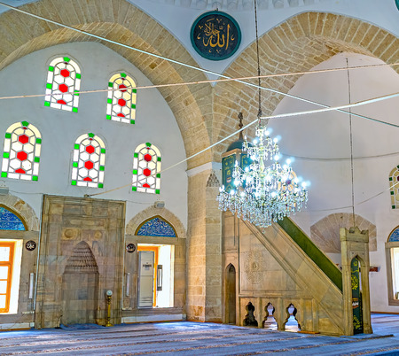 ANTALYA, TURKEY - MAY 6, 2017: The interior of Tekeli Mehmet Pasa Mosque decorated with stained glass windows, arabic calligraphy and carved details, on May 6 in Antalya.