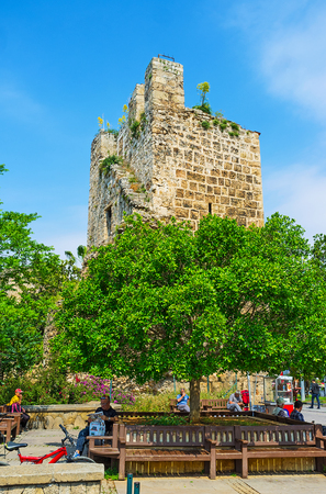 ANTALYA, TURKEY - MAY 6, 2017: The small park at the ancient ramparts is the best place to relax in Cumhuriyet avenue, on May 6 in Antalya. Editorial