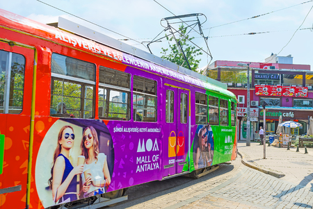 ANTALYA, TURKEY - MAY 6, 2017: The colorful trams attract tourists to ride along the shopping streets of the city, on May 6 in Antalya. Editorial