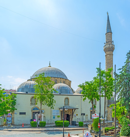 ANTALYA, TURKEY - MAY 6, 2017: The old Tekeli Mehmet Pasa Mosque with tall minaret and huge dome, supported by semi domes, on May 6 in Antalya. Editorial