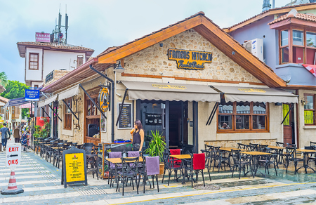 ANTALYA, TURKEY - MAY 6, 2017: Kaleici district boasts large amount of different cafes, bars and restaurants, located in old streets, tiny gardens or crowded squares of this tourist area, on May 6 in Antalya. Imagens - 79843982
