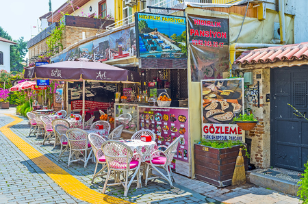 ANTALYA, TURKEY - MAY 6, 2017: The cozy outdoor cafe in Kaleici district with fresh bar and local dishes, on May 6 in Antalya.