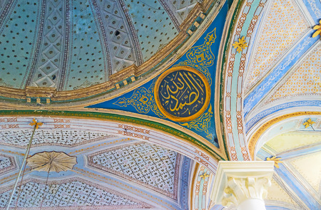 ceiling plate: ANTALYA, TURKEY - MAY 6, 2017: The ceiling of Aladdin Mosque in Kaleici decorated with calligraphic plates, surrounded by complex patterns, on May 6 in Antalya.