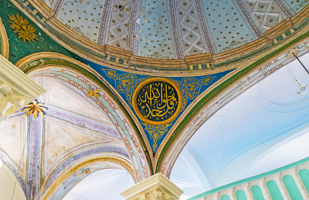 ANTALYA, TURKEY - MAY 6, 2017: The dome and arches in Aladdin Mosque in Kaleici with colorful patterns and arabic calligraphy, on May 6 in Antalya.