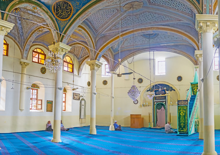 ANTALYA, TURKEY - MAY 6, 2017: Interior of Aladdin Mosque with tall white columns, light walls and blue ceiling, decorated with fine islamic patterns, on May 6 in Antalya. Editorial