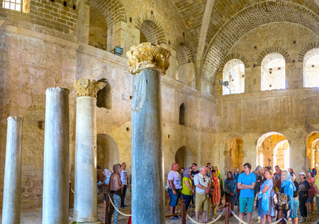 DEMRE, TURKEY - MAY 7, 2017: The group of tourists in nave of St Nicholas Church, the main christian shrine of the region, on May 7, in Demre.