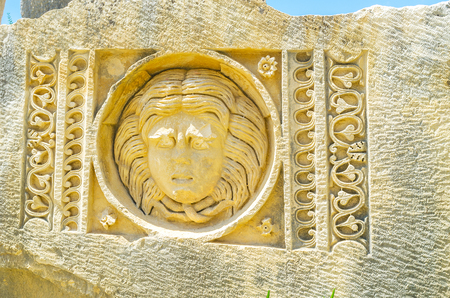 archaeological: The stone head is the decoration element of ancient theater in Myra, Turkey.