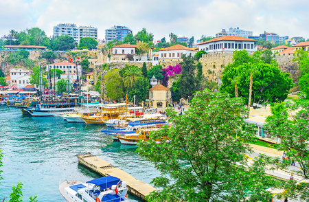 The view of old port with the Iskele Mosque, located next to the old fortress wall, Antalya, Turkey.