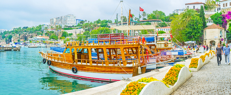 ANTALYA, TURKEY - MAY 6, 2017: The old marina decorated with scenic flower beds in wave shaped stone tubs, on May 6 in Antalya. Editorial
