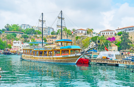The old marina is historic site with preserved medieval landmarks, nice cafes, small parks and large amount of pleasure boats and yachts, Antalya, Turkey.