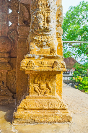 vihara: Detail of the column of the porch of Gadaladeniya Vihara Buddhist Temple with lion and dwarf, Pilimathalawa, Sri Lanka.