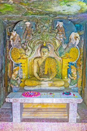 vihara: PILIMATHALAWA, SRI LANKA - NOVEMBER 11, 2016: The preserved sculptures in the image house of Vijayantha Prasada shrine of Gadaladeniya Vihara Buddhist Temple, on November 11 in Pilimathalawa.