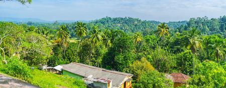 kandy: The deep jungle forests surround the Panhangala Rock with its ancient Buddhist Temple, Udunuwara, Sri Lanka. Stock Photo