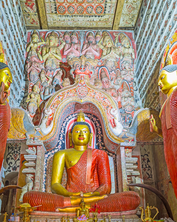ceylon: UDUNUWARA, SRI LANKA - NOVEMBER 29, 2016: Interior of the image house of Lankathilaka Vihara with the giant golden statue of Meditating Buddha under the Dragon Arch, on November 29 in Udunuwara.