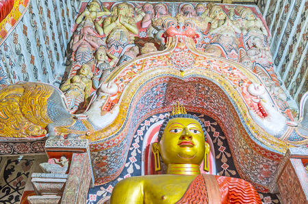 vihara: UDUNUWARA, SRI LANKA - NOVEMBER 29, 2016: The Dragons Arch in Lankathilaka Vihara is richly decorated  with painted patterns and relief sculptures of Hindu deities, on November 29 in Udunuwara. Editorial